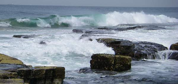 Ocean waves breaking against a rocky coast