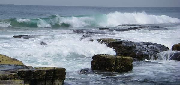 Ocean waves breaking against a rocky coast