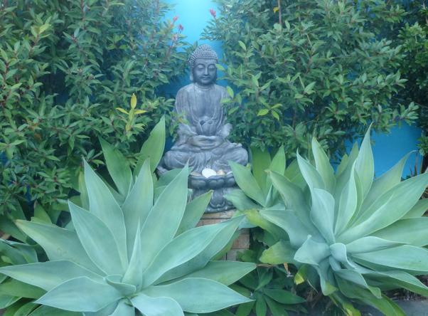 Buddhist statue in a garden